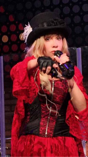 Lisa pointing in red with hat